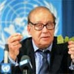 Jean Ziegler speaking for the United Nations, behind microphone.