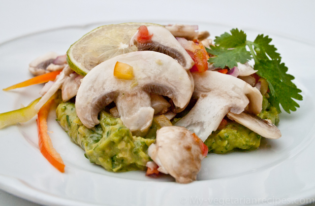 Mushroom slices over avocado cream.